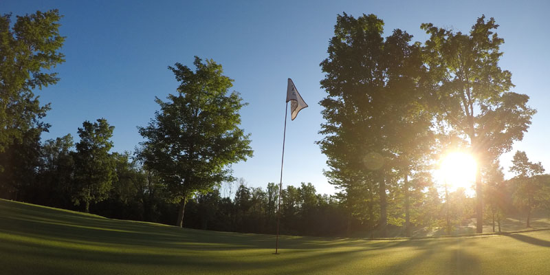 Photo of Par 4 Hole 16 at sunrise at Tamarack Golf Club in Oswego, NY.